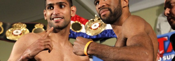 WBA/IBF light welterweight champion (l) poses with challenger Lamont Peterson to promote their title fight tomorrow night. Photo: Jacquelyn Martin/AP